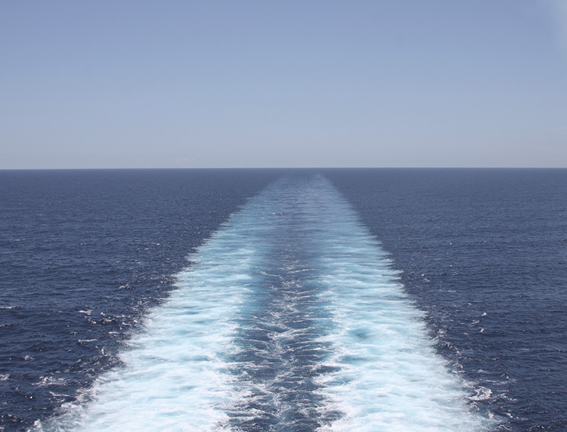 View of the ocean from the back of a ship