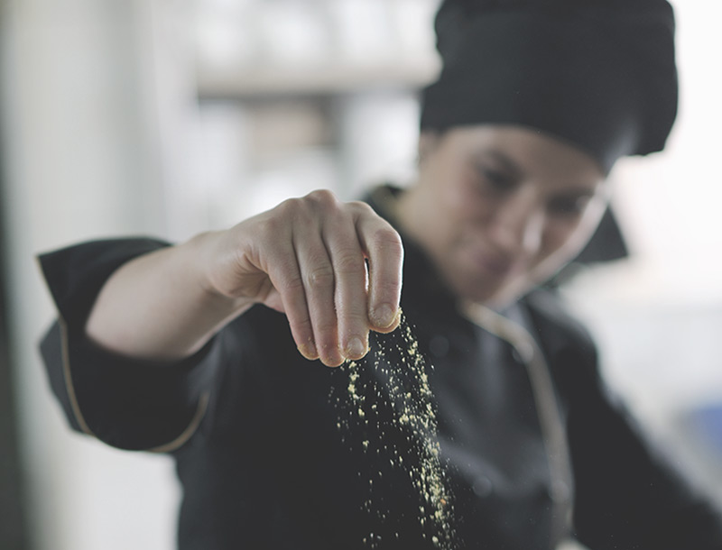 a chef is sprinkling salt on something