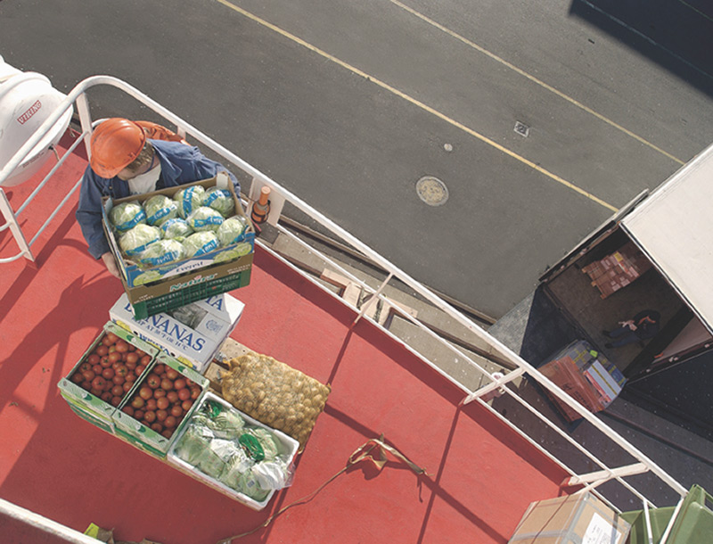 vessel crewmember lifting provisions from a Garrets delivery